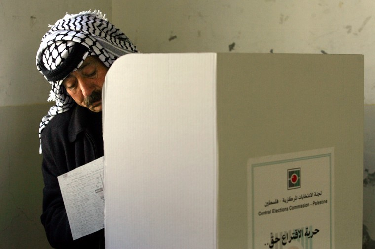 A Palestinian police officer votes in parliamentary elections in the West Bank city of Nablus on Sunday.
