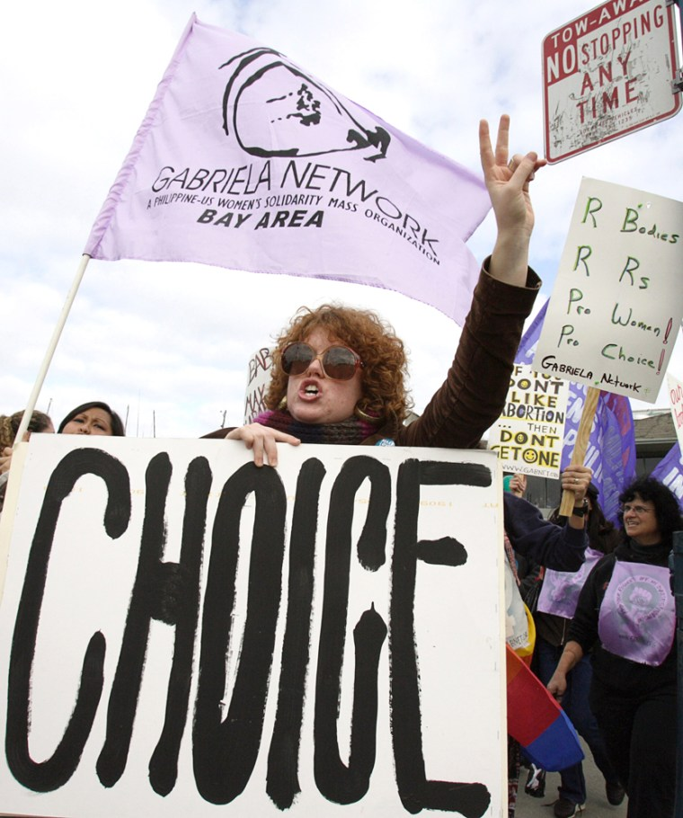 Abortion rights activists yell out against a march of anti-abortion activists in San Francisco