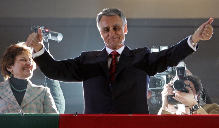 Portugal's new president Anibal Cavaco Silva greets supporters after the electoral results announcement in Lisbon