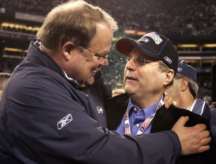 Seahawks coach Holmgren congratulates team owner Allen after winning NFL's NFC Championship game in Seattle
