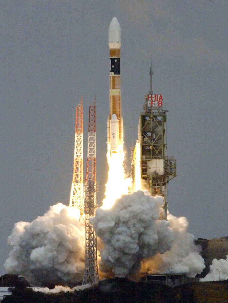 Japanese H-2A rocket carrying a satellite blasts off on the southern island of Tanegashima