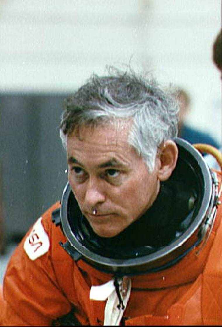 Astronaut Mike Mullane listens to emergency egress instructions during a briefing held at NASA's Johnson Space Center in advance of his 1990 shuttle mission.