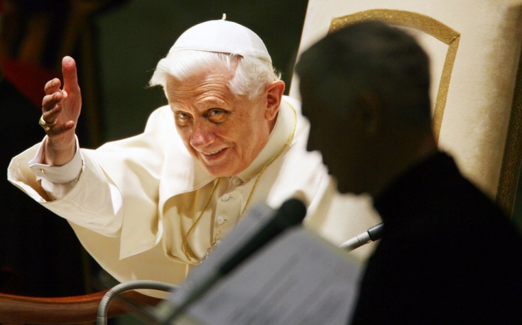 Pope Benedict XVI acknowledges cheering crowd during weekly general audience at Vatican