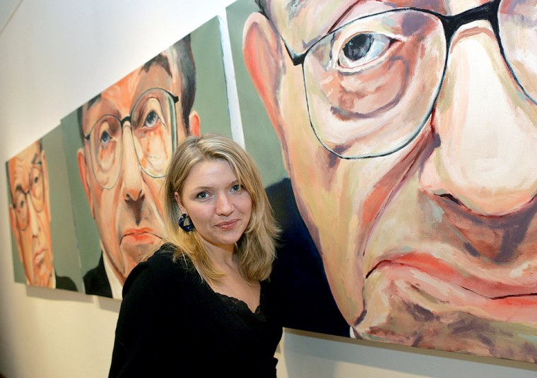 """Artist Crowe poses with her paintings at \""""Good-bye...Greenspan\"""" art exhibition in New York"""