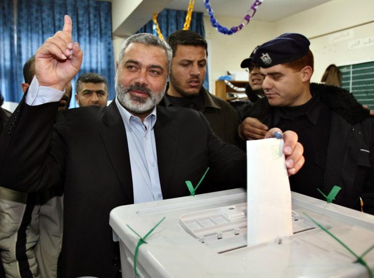 Senior Hamas leader Haniyeh casts his ballots inside polling station in Gaza City