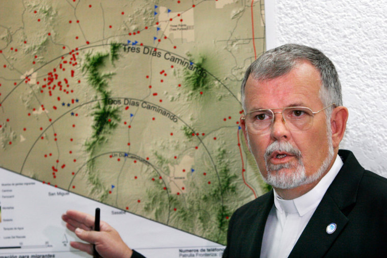 The Rev. Robin Hoover, president of the U.S.-basedHumane Borders group,showsmigrant deaths (red dots) in the Arizona desert during a Mexico City news conference Tuesday with Mexico's National Commission for Human Rights. The commissionwill post signs and distribute maps to migrants that were produced by Humane Borders.