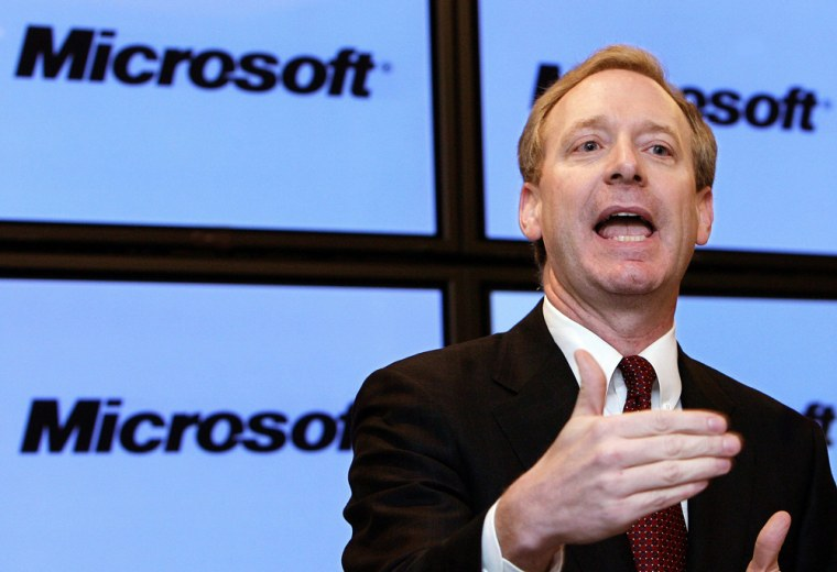 Microsoft Corp's General Counsel Smith speaks at news conference in Brussels