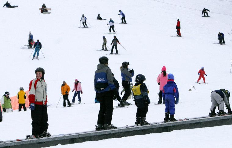 Beginner skiers ride an escalator at Attitash Ski area in Bartlett, N.H., Wednesday, Dec. 28, 2005.