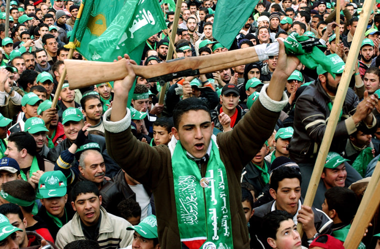 Palestinian Hamas supporters celebrate their landslidevictory in parliamentary elections in the West Bank City of Nablus on Thursday.
