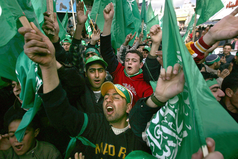 Palestinian supporters of Hamas celebrate their victory in parliamentary elections, in the West Bank town of Ramallah onThursday.