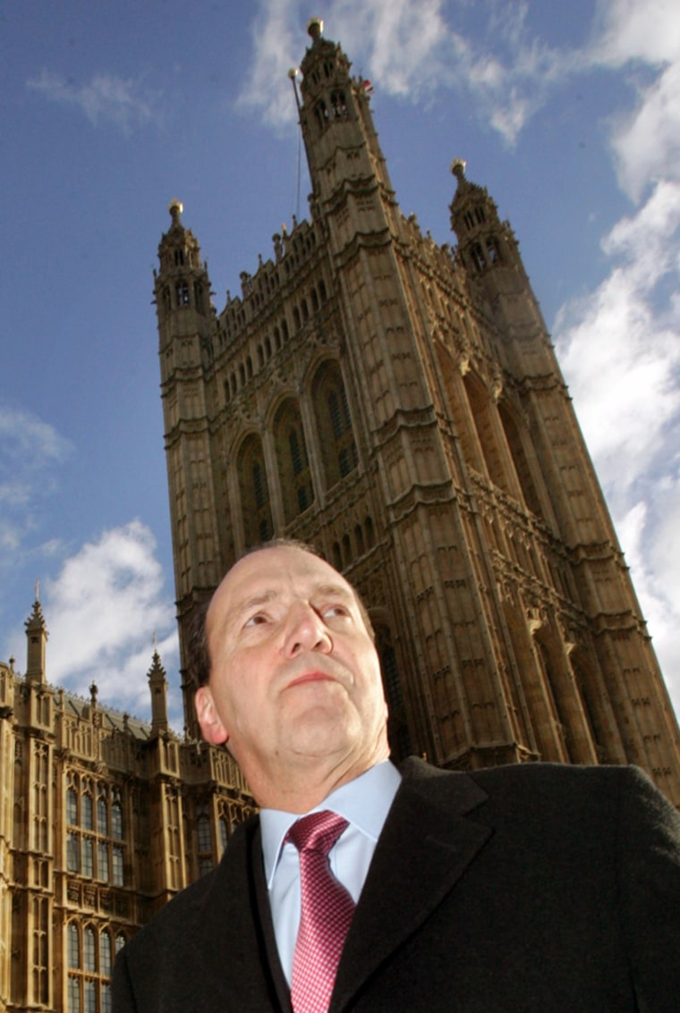 British Liberal Democrat MP Hughes walks to Houses of Parliament in Westminster, central London