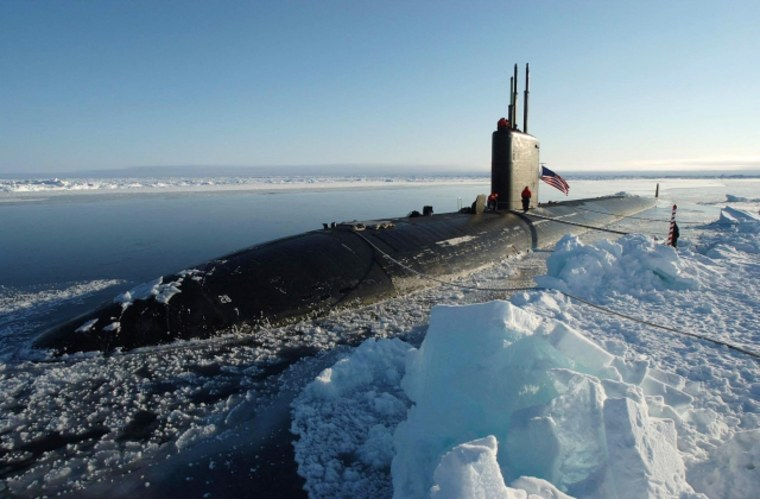 The attack submarine USS Hampton is seen here in April 2004 having surfaced at the North Pole. U.S. submarines often navigate through waters claimed by Canada to get to the North Pole and other areas.