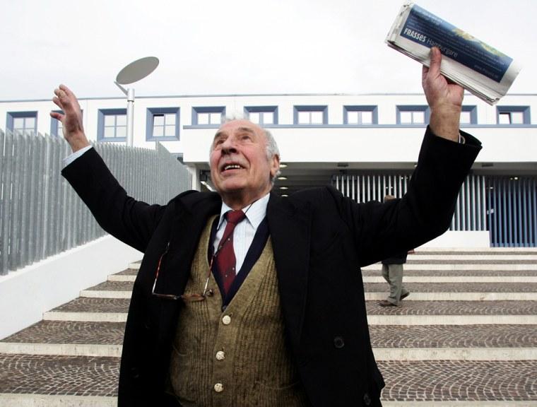Luigi Cascioli gestures in front of the
