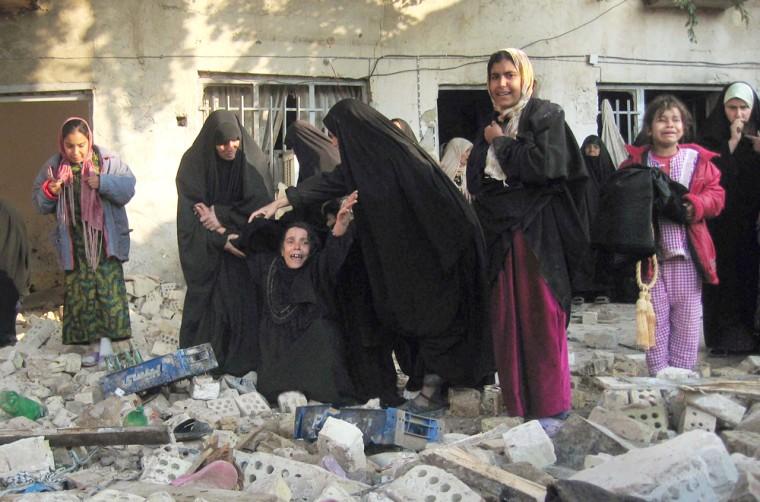 WOMEN MOURN BOMB SCENE