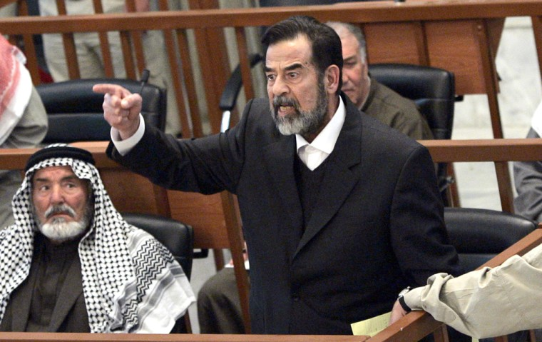 Former Iraqi president Saddam Hussein chastises the court moments after his half brother, Barzan Ibrahim was forcibly removed from the trial held in Baghdad's heavily fortified Green Zone on Sunday.