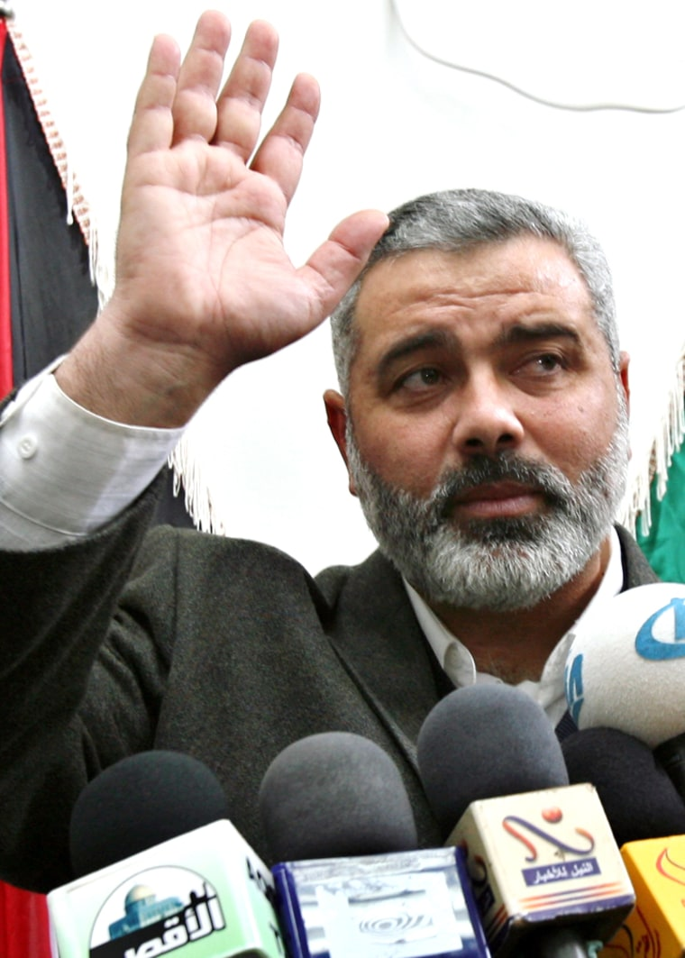 Senior leader and head of Hamas' list of candidates, Ismail Haniyeh, waves after his news conference in Gaza City