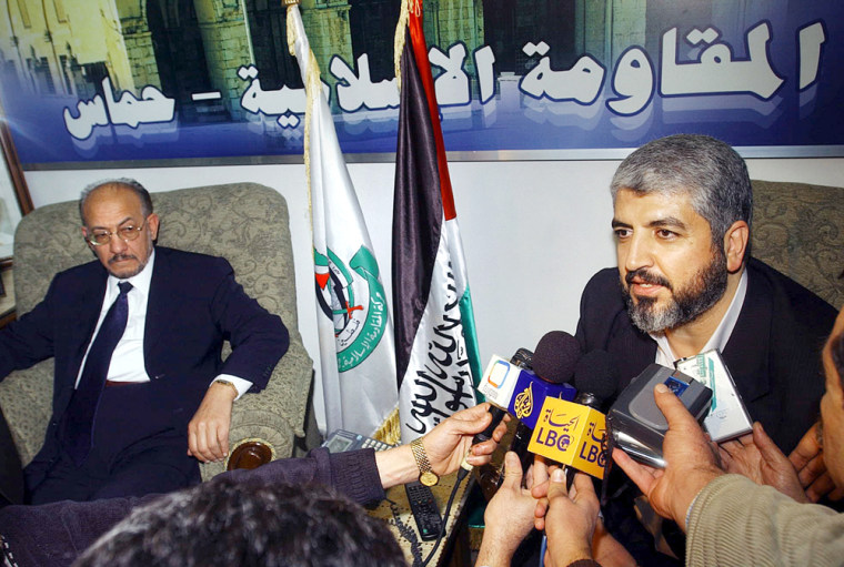 Hamas leader Khaled Mashaal, right, talks to reporters in Damascus, Tuesdaywhile receiving a Jordanian delegation of Islamic parties headed by Abdul-Majeed Zneibat of the Brotherhood party in Jordan, left.
