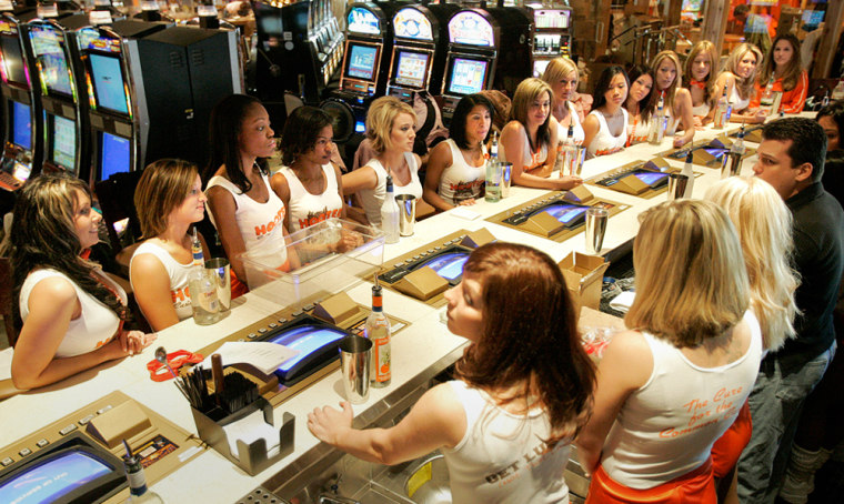 Bartenders gather at the bar area for training at Hooters hotel-casino in Las Vegas on Wednesday. Hooters' first ever hotel-casino, featuring 696 rooms and a 30,000 square foot casino with more than 200 Hooters Girls, officially opens on Friday.