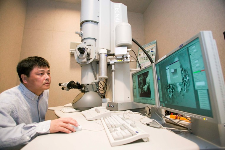 Zurong Dai, a researcher at Lawrence Livermore National Laboratory, uses a transmission electron microscope to capture close-up images of cometary dust collected by NASA's Stardust spacecraft.
