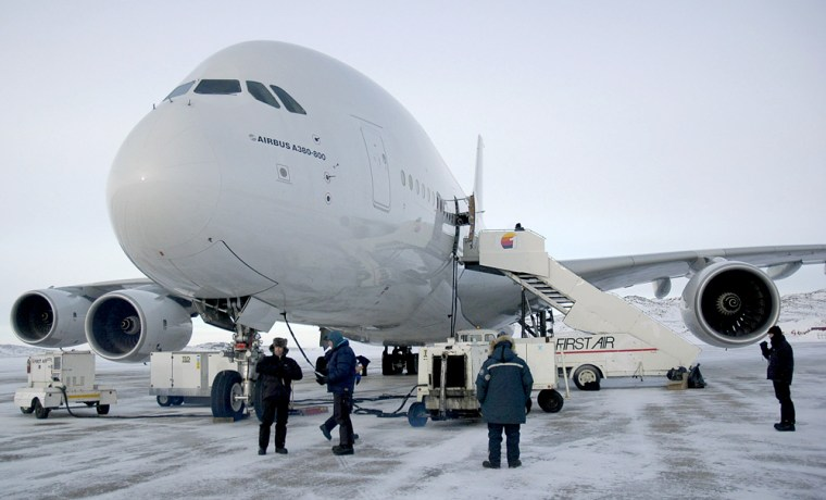 Ground crew tend to an Airbus A380 in Iqaluit, Nunavut — the Inuit territory of Canada opposite Greenland. Airbus engineers are putting the world's largest passenger airplane through its cold-weather paces.