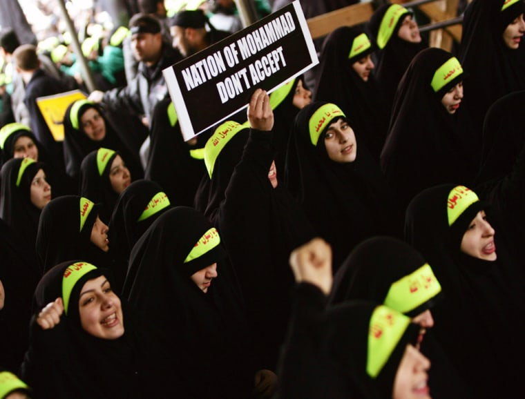 Lebanese Hizbollah supporters chant slogan during Ashoura ceremony in Beirut