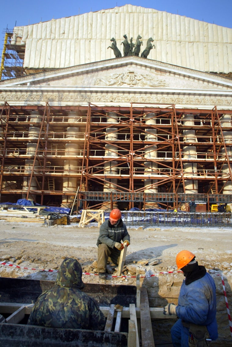 The facade of the famed Bolshoi Theater in Moscow is covered in scaffoldingaswork continues on a major restoration.The work is intended to bring the theater in line with the technical demands of modern ballet and opera productions. It is due to reopen its doors in March 2008.