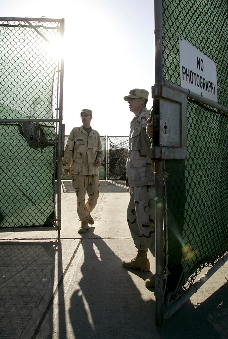 US Navy guards open gate to Camp Delta in Guantanamo Bay