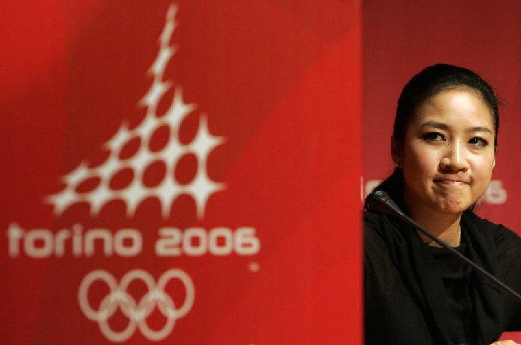 U.S.figure skater Michelle Kwan grimaces during a news conference at the 2006 Turin Winter Olympic Games Feb. 12.Kwan dropped out of the Turin Games on Sunday morning because of a groin injury, bringing her decade-long quest for Olympic gold to a humbling end.
