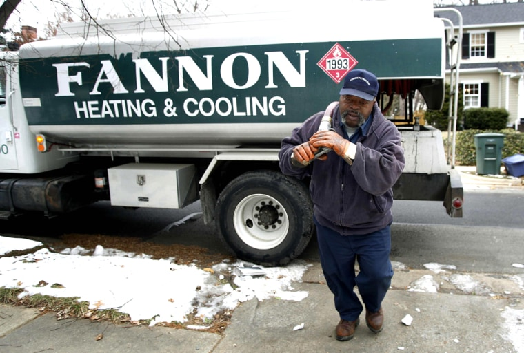 Man prepares to deliver heating oil to a house in Alexandria
