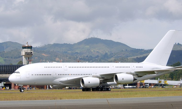 The jumbo jet A380 is seen in the airport of Medellin, Colombia earlier this year in this file photo. One man broke his leg and 32 other people suffered minor injuries during the exercise in which 853 passengers and 20 crew exited the plane on slides in a darkened hangar Sunday in Hamburg, Germany.