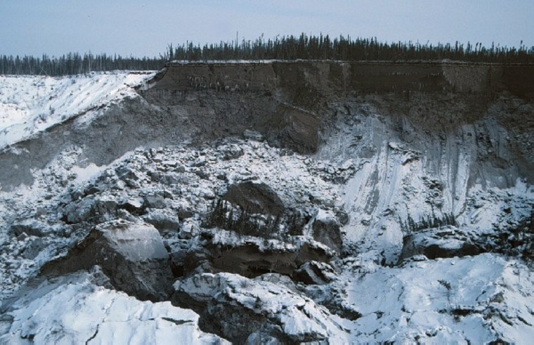 Block landslide in permafrost along Mackenzie River, near Old Fort Point. Landslide occurred in the winter of 1997 and flowed onto the frozen river. Photo taken March 1997