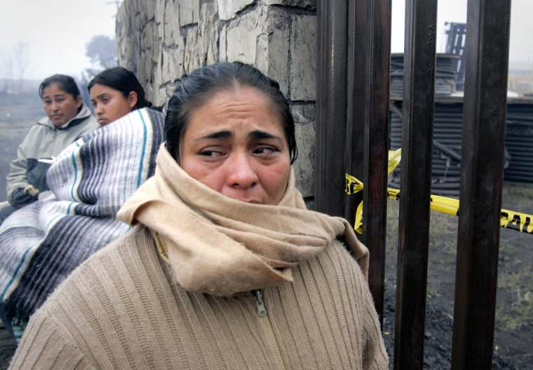 Relatives of trapped miners wait outside the main gate of the Pasta de Conchas No. 8 coal mine in San Juan de Sabinas, Mexico, on Tuesday.