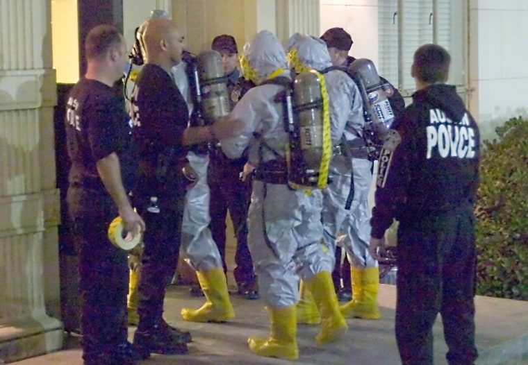 Members of the Austin Fire Department Special Operations Hazardous Materials Regional Strike Team enter Moore-Hill Dormitory to investigate the presence of ricin, a toxin that was discovered by a Moore-Hill resident Thursday in a roll of quarters.