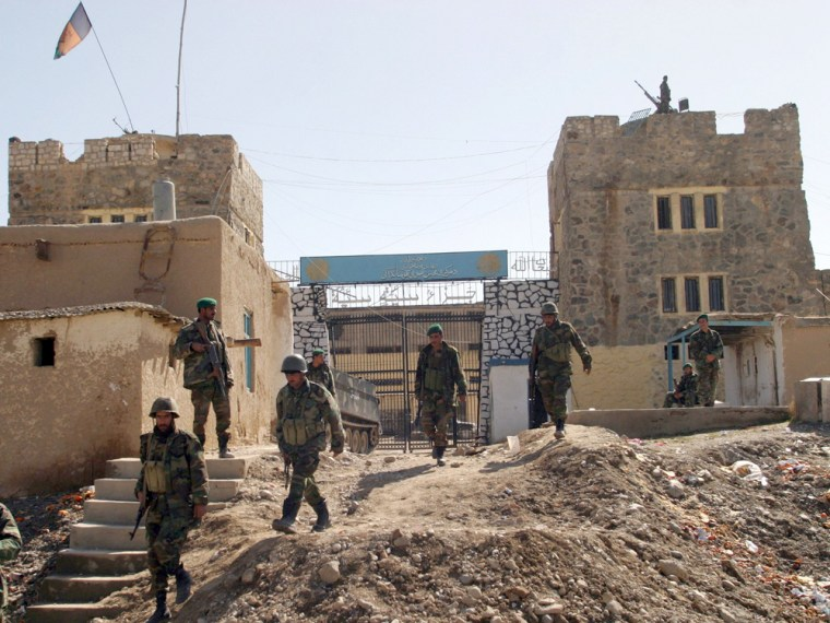 Afghan soldiers come out of the Pul-i-Charkhi prison on the eastern outskirts of Kabul