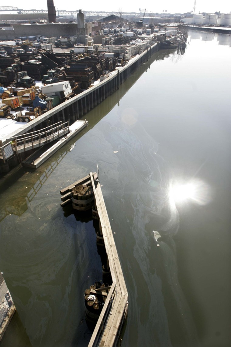 An oil sheen swirls atop Newton Creek in the Greenpoint section of Brooklyn, New York, lastFeb. 16. Some localresidents have sued Exxon, Chevron and BP to force the expedited cleanup of an estimated 17-million-barrel underground oil spill containing more petroleum than the Exxon Valdez dumped off Alaska.