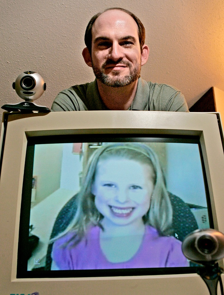 "Michael Gough, an advocate for ""virtual visitation"" rights, poses with his daughter Saige shown on his computer monitor."