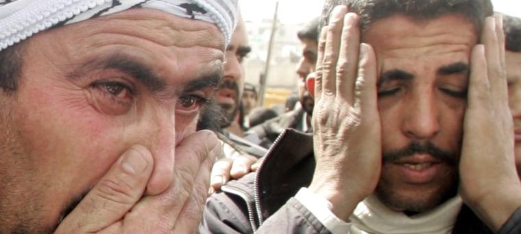 Relatives of senior Islamic Jihad commander react in al-Shifa hospital in Gaza