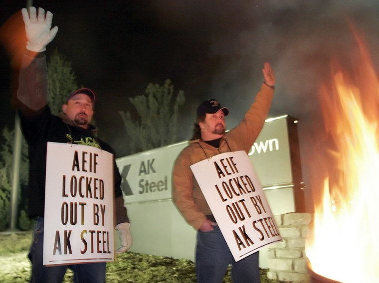 Union members wave to supporters as they picket at AK Steel shortly after the company locked out its hourly workers Wednesday after failing to reach an agreement on a new contract.
