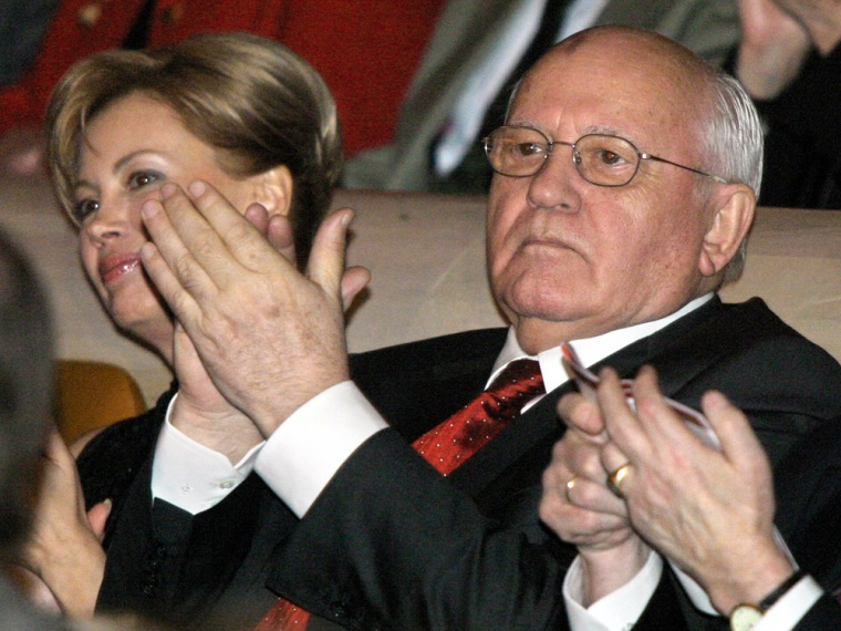 Former Soviet leader Gorbachev, sitting next to his daughter Virganskaya, applauds during a concert in Moscow