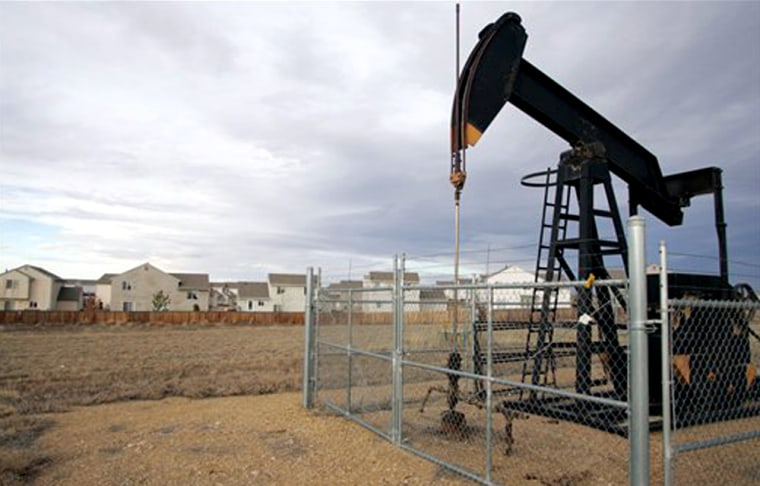 Energy companies are snapping up land along the Rockies, including this plot next to homes in Frederick, Colo.
