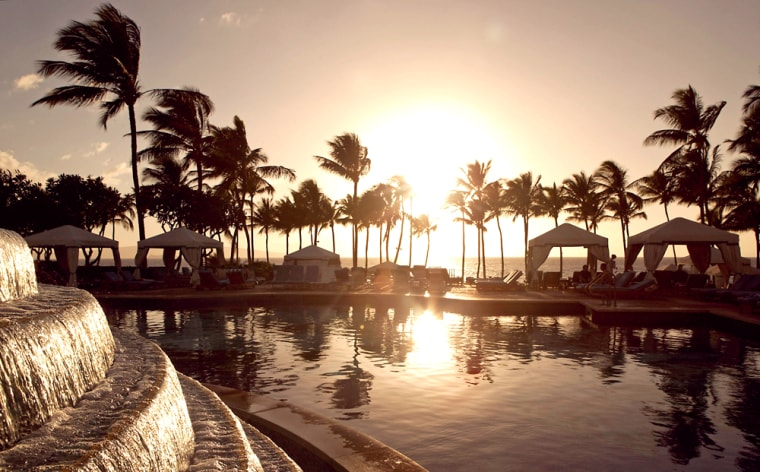 A view of the sun setting poolside from the Grand Wailea Resort, Feb. 6, 2006 in Wailea, Maui, Hawaii.