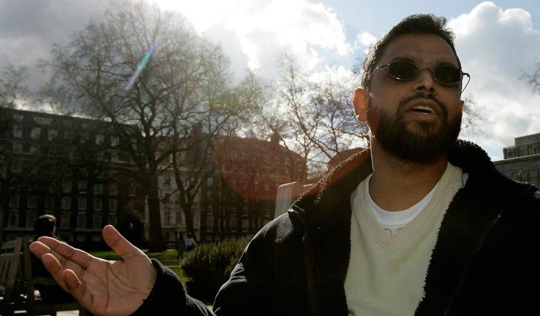Moazzam Begg talks with an AssociatedPress reporter in London.