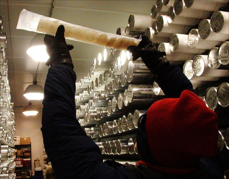 An ice core taken fromAntarctica's Lake Vostok is examined at the National Ice Core Lab in Denver, Colo. A new study used the 610,000-year history of the cores to detect a slow feedback mechanism that regulates Earth's climate.
