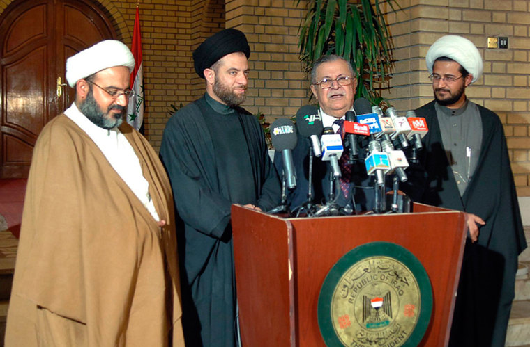 Iraqi President Jalal Talabani, second right, said on Monday he would call the country's new parliament into session for the first time on March 12.