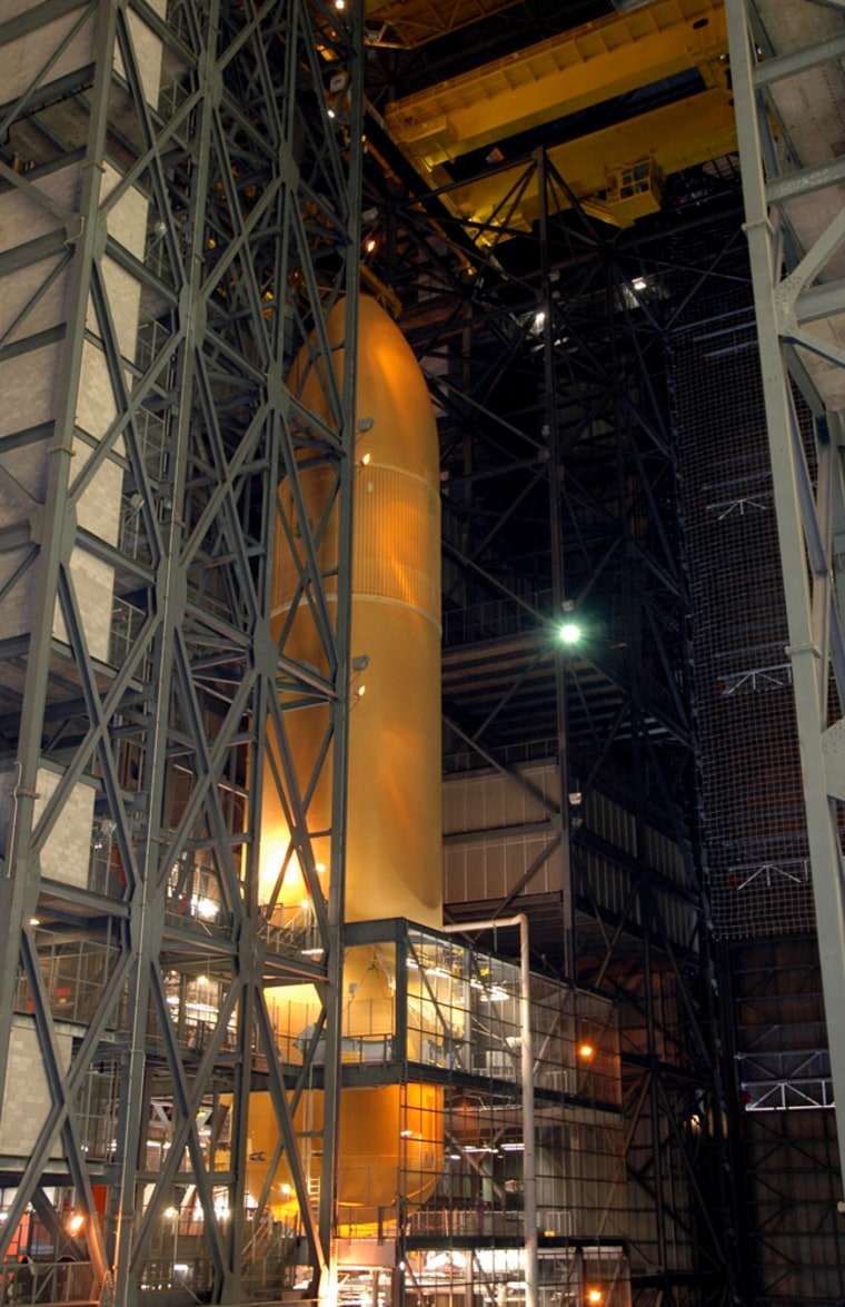 The external fuel tank for Discovery's next mission has been lowered into a checkout cell within Kennedy Space Center's cavernous Vehicle Assembly Building for further work. One of the issues to be checked involves the tank's low-level fuel sensors, which sparked a delay in Discovery's last launch.