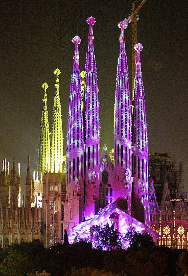 Antoni Gaudi's unfinished Sagrada Familia, is lit up during a fireworks and light show display in Barcelona, Spain, Saturday, June 1, 2002, celebrating the 150th anniversary of the birth of this Catalonian architect.