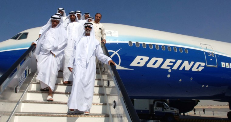 Sheikh Nahyan Bin Mubarak Al Nahyan, U.A.E. minister of education, leads a group of visitorsout of a Boeing 777 exhibited at the Dubai Air Show in November.