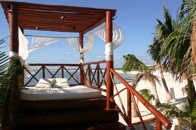 Lounge pavilions line the beach at the El Dorado Seaside Suites resort on the Riviera Maya in Mexico.