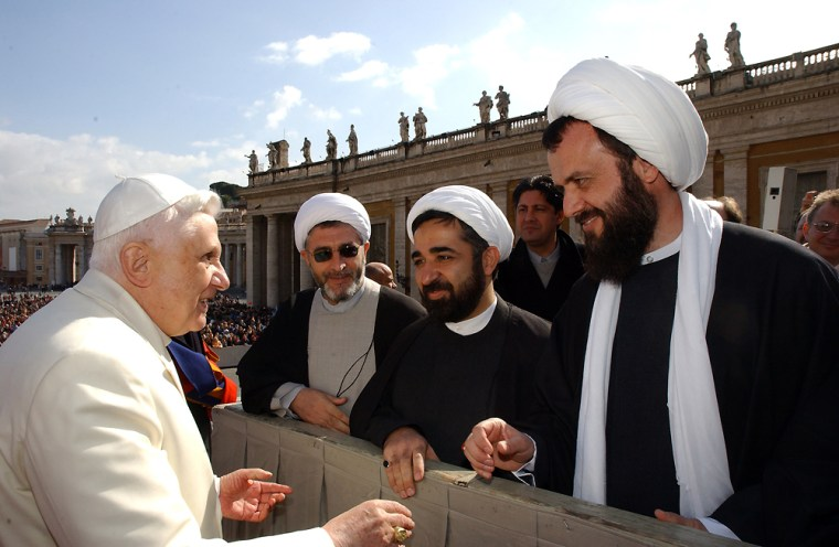 Pope Benedict XVI speakswith members of a Muslim delegationfrom the United States during an open-air general audience in St. Peter's Square an on March 1.