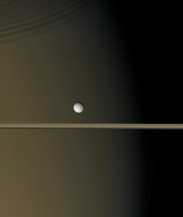 Enceladus shines as a bright pearl against the backdrop of Saturn and its rings in this image taken by the Cassini spacecraft in January. The tiny moon is just 505 kilometers (314 miles) across.